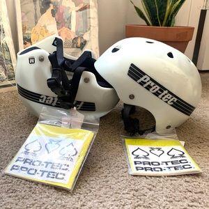 Two white Pro Tec helmets